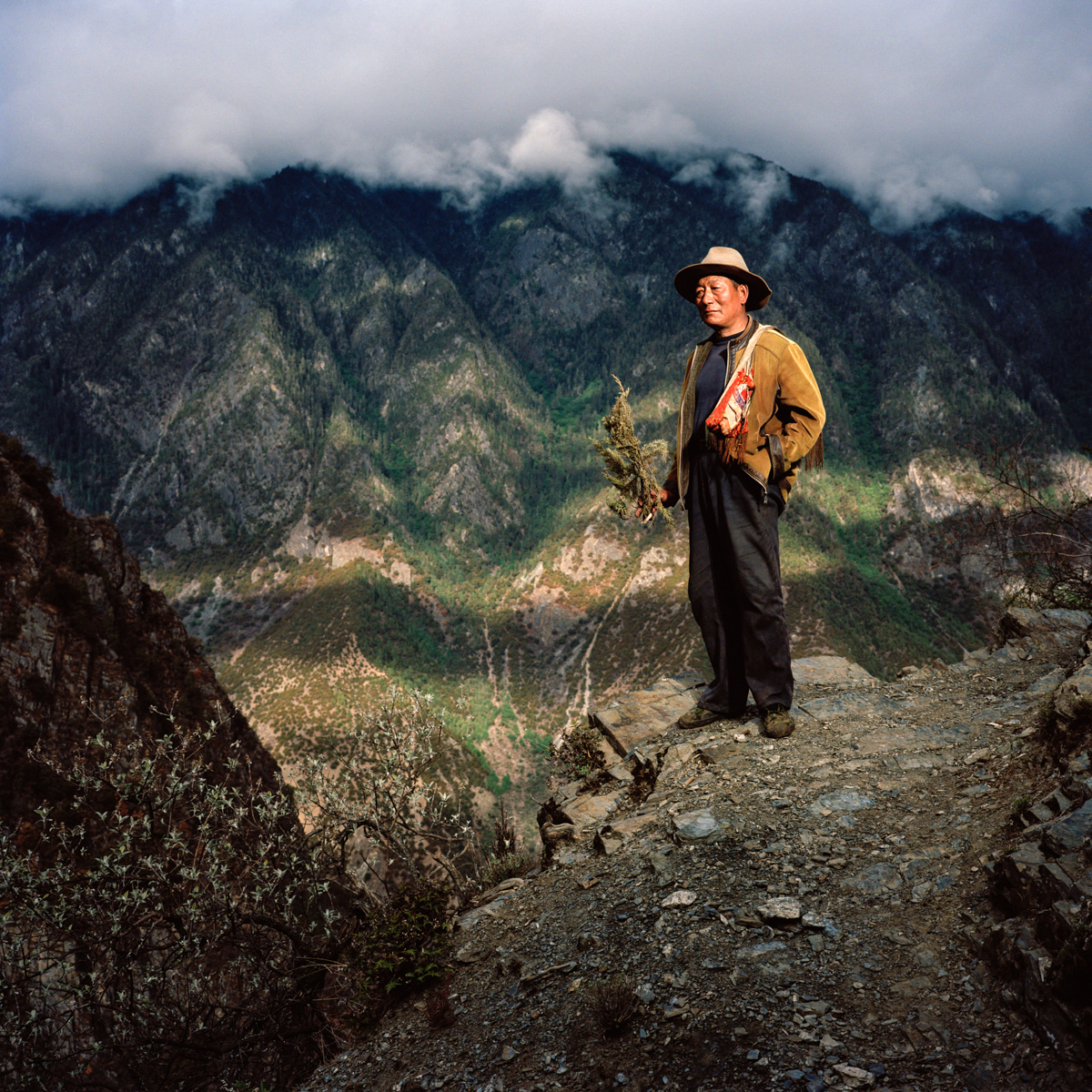 May 2012. Tibet province, China. Portrait of a Tibetan farmer from the village of Laide at 3100m high on the trail of the buddhist pilgrimage of the Kawa Karpo.